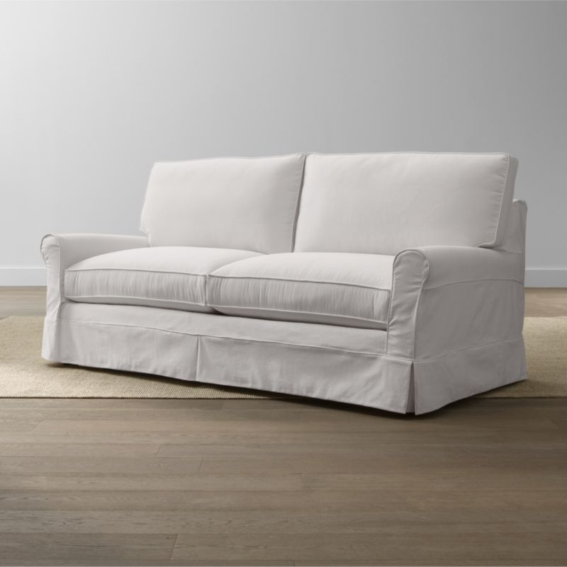 Keep your Harborside Apartment Sofa looking as fresh as the day you brought it home with this convenient, carefree replacement slipcover. Fitted cotton-blend slipcover is tailored with crisp inverted kick pleats and self-welting to keep it neatly in place. Harborside Apartment Sofa Replacement Slipcover is a Crate and Barrel exclusive.<br /><br /><NEWTAG/><ul><li>Removable slipcover is machine washable</li><li>Self-welting</li><li>Made in North Carolina, USA</li></ul>