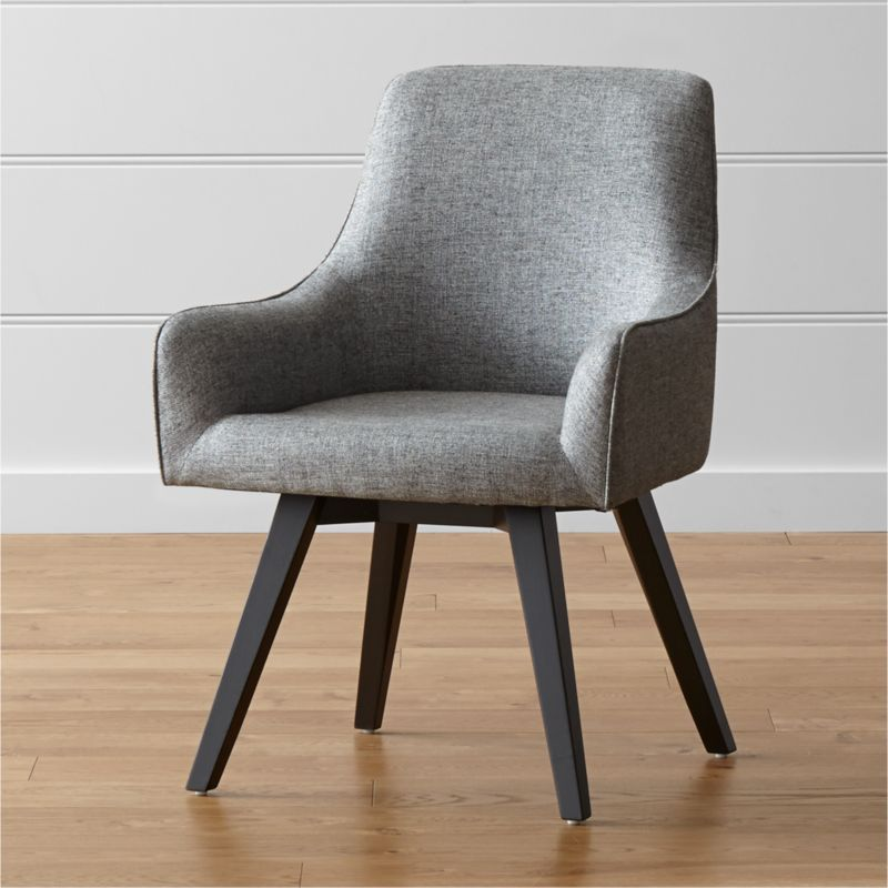 Sculpted for comfort and given contemporary styling, this black swivel chair is designed to put everyone at ease. Angled legs and black-and-white tweed blended fabric give Harvey a smart look for any office setting, be it classic or contemporary. <NEWTAG/><ul><li>Designed by Bethan Gray</li><li>Plywood seat and bent plywood back</li><li>Solid hardwood legs with black stain and clear lacquer topcoat</li><li>Viscose-linen blend upholstery with self-welt detailing</li><li>360-swivel mechanism</li><li>Polyfoam tight back and seat</li><li>Plastic glides</li><li>Made in China</li></ul><br />
