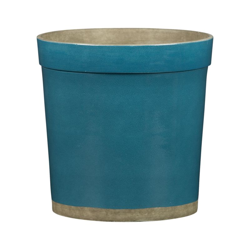 Clean-lined planter sets off potted foliage and flowers with a pop of pure color. Artisanal modern planter is handcrafted of earthenware, hand glazed and hand painted in teal with base and interior left natural. Each unique piece will exhibit subtle variations.<br /><br /><NEWTAG/><ul><li>Handcrafted</li><li>Earthenware</li><li>For indoor or covered outdoor use</li><li>Indoor use during freezing temperatures recommended</li><li>Made in The Philippines</li></ul>