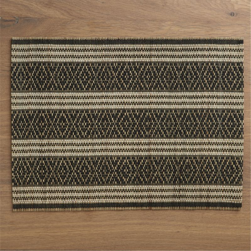 Black threads are handwoven over mendong fiber slats to create a graphic, geometric diamond pattern with modern, ethnic flair. Placemat rolls  up for easy storage.<br /><br /><NEWTAG/><ul><li>Handwoven</li><li>90% mendong and 10% thread</li><li>Wipe with damp cloth</li></ul>