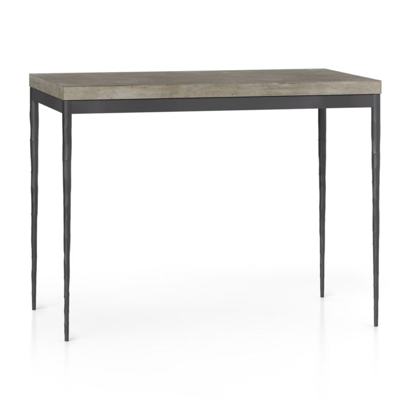 "You've designed your ideal table, from top to bottom in just the right size. The warm grey concrete top is a mix of marble, stone and granite powders with natural fibers for added strength. This industrial, modern surface is handmade in an eco-friendly shop powered without fossil fuels. Due to the handmade nature of the concrete mix, color will vary and may change over time. Slim tapered legs accentuate the graceful profile of the steel base, hammered to resemble artisanal metalsmithing. A dark finish and a protective top coat enhance its sculptural appeal. Counter-height high dining table seats up to 4. The Concrete Top/Hammered Base 48""x28"" High Dining Table is a Crate and Barrel exclusive.<br /><br /><br /><NEWTAG/><ul><li>Handmade concrete top of stone, marble, granite and natural fibers</li><li>Hairline fractures and slight tolerance for fit to base are characteristics of the concrete</li><li>Steel base with dark finish and clear polyurethane topcoat</li><li>Levelers</li><li>Accommodates counter stools</li><li>Seats 4</li><li>Made in Vietnam</li></ul>"