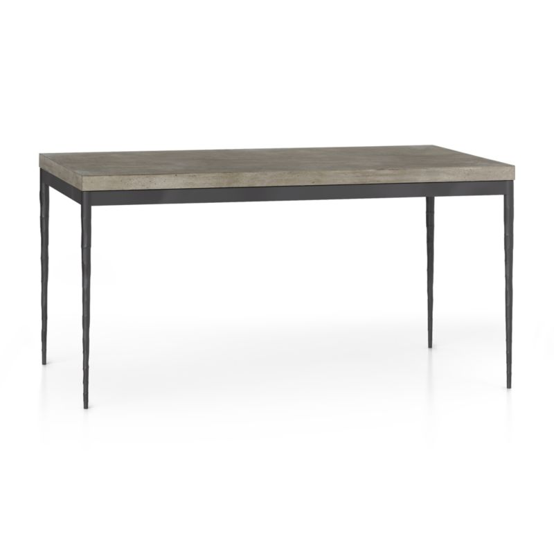 """You've designed your ideal table, from top to bottom in just the right size. The warm grey concrete top is a mix of marble, stone and granite powders with natural fibers for added strength. This industrial, modern surface is handmade in an eco-friendly shop powered without fossil fuels. Due to the handmade nature of the concrete mix, color will vary and may change over time. Slim tapered legs accentuate the graceful profile of the steel base, hammered to resemble artisanal metalsmithing. A dark finish and a protective top coat enhance its sculptural appeal. Sized to seat up to 6, this table is perfect for everyday dining or entertaining. The Concrete Top/Hammered Base 60""""x36"""" Dining Table is a Crate and Barrel exclusive.<br /><br /><NEWTAG/><ul><li>Handmade concrete top of stone, marble, granite and natural fibers</li><li>Hairline fractures and slight tolerance for fit to base are characteristics of the concrete</li><li>Steel base with dark finish and clear polyurethane topcoat</li><li>Levelers</li><li>Seats 6</li><li>Made in Vietnam</li></ul>"""