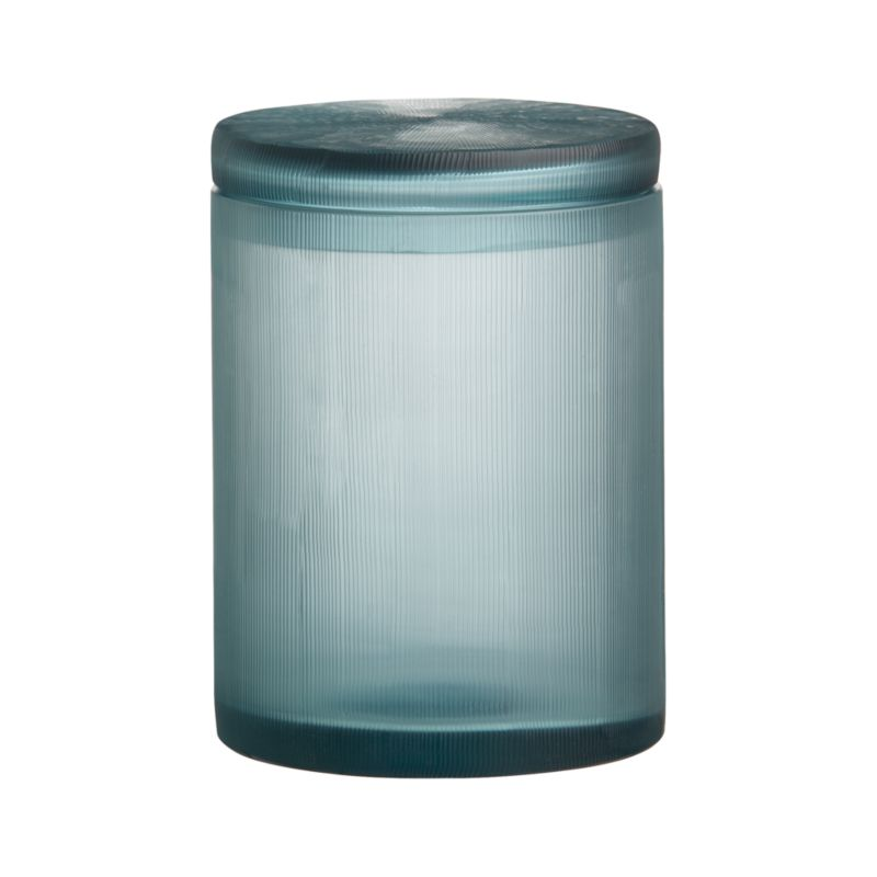 Translucent cerulean blue glass bath accessories shimmer seaside color and artisan craftsmanship, delicately textured with hand-carved fine lines. Clean, lidded jar keeps cotton balls, swabs, bath salts and other bathroom necessities near at hand and softly in view.<br /><br /><NEWTAG/><ul><li>Handcrafted</li><li>Glass</li><li>Wipe clean with damp cloth</li></ul>