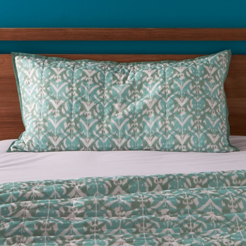 Gorgeous tones of blue and green overlap in a modern ikat pattern that reverses to solid aqua, crafted of soft, 100% cotton. Sham is piped in solid aqua and has a generous overlapping back closure. Bed pillows also available.<br /><ul><li>Hand-quilted</li><li>100% cotton</li><li>100% cotton fill</li><li>Overlapping back closure</li><li>Machine wash, tumble dry low; warm iron as needed</li><li>Made in India</li></ul><br /><NEWTAG/>