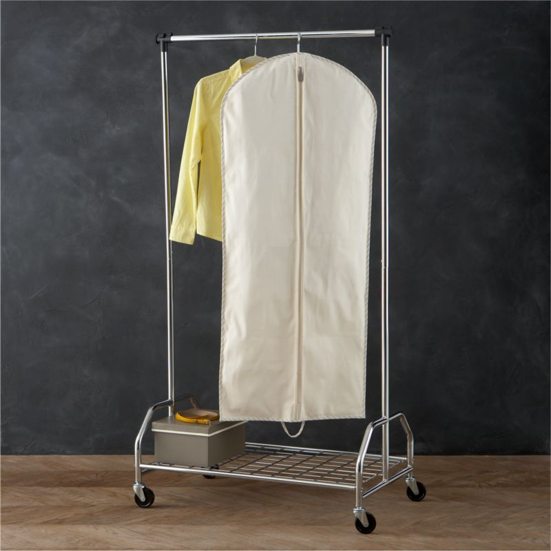 Keep your blankets, linens and other fine garments in pristine condition with our exclusive vintage-inspired storage bag collection. Handmade with all-natural 100% cotton-twill canvas, each bag is exceptionally durable and breathable to protect and preserve the fibers of your clothes and textiles. Trimmed with a classic ticking stripe, this hanging garment bag stows out-of-season and formal clothing, coats and costumes. Full-length zipper with leather pull provides easy access.<br /><br /><NEWTAG/><ul><li>100% cotton-twill storage bag with cotton-polyester ticking edge</li><li>Steel hanger</li><li>Leather zipper pull</li><li>Natural cotton prevents color transfer</li><li>Clean with a damp cloth</li><li>Made in China</li></ul>
