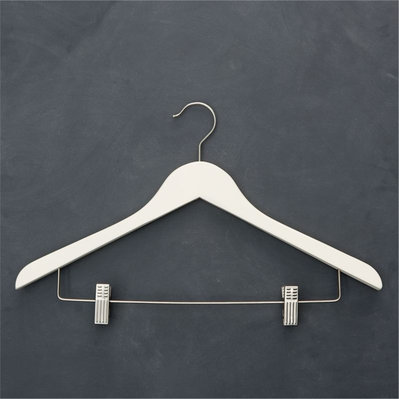 For a closet you can take pride in, quality maple hangers painted matte ivory replace mismatched hangers with a clean, cohesive look. Stainless steel bar has two sturdy clips that adjust to fit any size skirt or pants; nonslip shoulder inserts retain slippery garments without puckering. Satin-finish hook swivels for convenience.<br /><br /><NEWTAG/><ul><li>Painted maple with stainless steel bar and clips</li><li>Clear matte lacquer finish</li><li>Rubber non-slip shoulder inserts</li><li>Satin stainless steel swivel hook</li><li>Clean with a damp cloth</li><li>Made in China</li></ul>