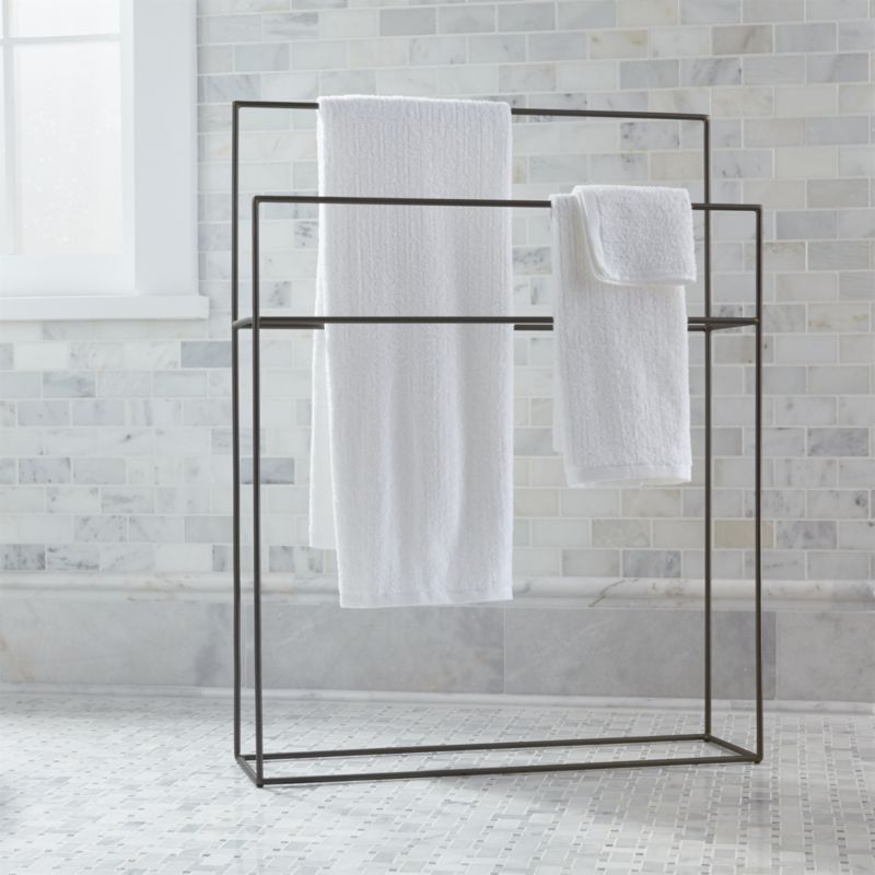 Streamlined with a hint of rustic, simple iron bath accessories outline functionality with a clean, timeless design. Free-standing rack maximizes space with two graduated hanging bars.<br /><br /><NEWTAG/><ul><li>Iron</li><li>Clean with damp cloth</li><li>Made in India</li></ul>