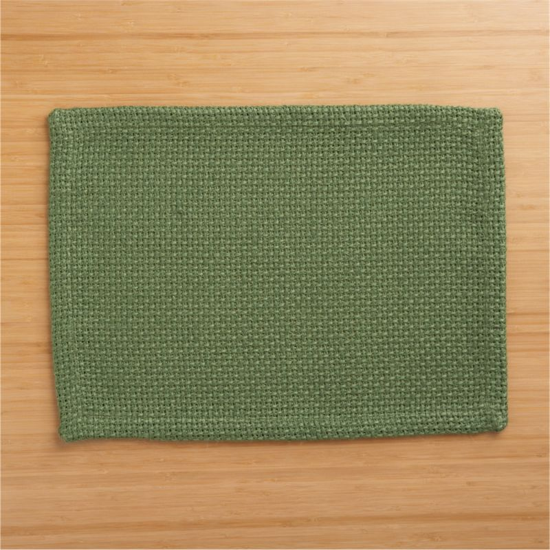 Tactile, beautiful jute shows off in a chunky, open weave placemat, setting a textural, solid green base for a range of colorful place settings.<br /><br /><NEWTAG/><ul><li>100% jute</li><li>Machine wash, dry flat; warm iron as needed</li></ul>