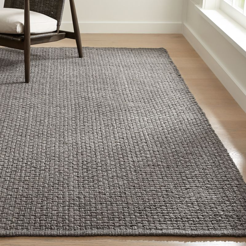 B With A Breezy Style This Natural Area Rug Is Handwoven From 100 Jute In Light Brown Tones For Tastefully Textured Look Neutral Hues