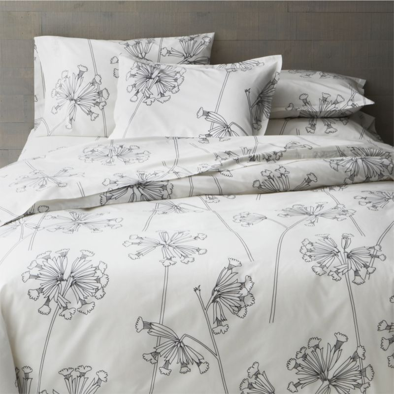 "While perusing an old botanical scrapbook, designer Erja Hirvi was struck by the structure of the cowslip (""Kevatesikko""), a flowering plant common to Europe. Her beautiful line drawings are a celebration of the plant's elegant form and intricate flowers, graphically rendered in black on crisp white. Reversible duvet cover has hidden button closure at bottom and interior fabric ties to hold the insert in place. Duvet inserts and bed pillows also available.<br /><br /><NEWTAG/><ul><li>Pattern designed by Erja Hirvi; 2011</li><li>100% cotton percale</li><li>300-thread-count</li><li>Machine wash, tumble dry</li><li>Made in Pakistan</li></ul>"