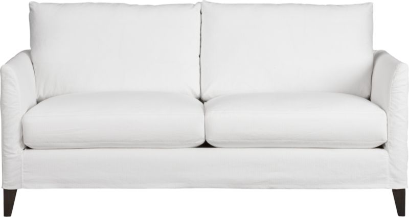 Tailored to fit our Klyne seating, chic slipcover is fashioned slim and minimal to make the most of its narrow tapered arms, plump cushions and tapered legs.<br /><br />After you place your order, we will send a fabric swatch via next day air for your final approval. We will contact you to verify both your receipt and approval of the fabric swatch before finalizing your order.<br /><br /><NEWTAG/><ul><li>72% cotton and 28% polyester</li><li>Machine wash</li></ul>
