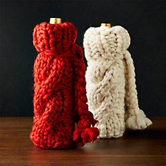 'Wine Accessories' from the web at 'https://images.crateandbarrel.com/is/image/Crate/KnitWineBagGrpFHF17/$categoryBorder$/170628163240/cozy-knit-wine-bag.jpg'