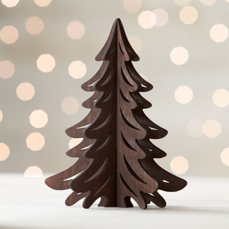 Graphic wood trees are laser-cut in realistic detail, easily assembled into dimensional, freestanding conversation pieces. Small tree with a dark finish can be paired with our laser-cut animals and village for a full decorative statement.<br /><br /><NEWTAG/><ul><li>Laser-cut plywood</li><li>Dark finish</li><li>3 pieces</li><li>Stores flat</li><li>For decorative use only; not a toy</li><li>Made in China</li></ul>