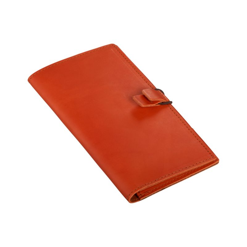 Slim wallet in orange full-grain, aniline-dyed leather travels light and smart with user-friendly compartments for credit cards, passport, tickets and pen. Elastic tab closure allows for easy access.<br /><br /><NEWTAG/><ul><li>Full-grain, aniline-dyed leather</li><li>Tab closure</li><li>Clean with leather cleaner</li><li>Made in Thailand</li></ul>