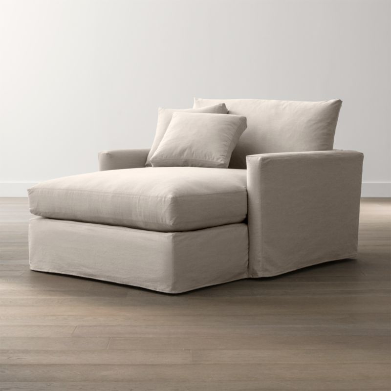 """Tailored to fit our Lounge Slipcovered Left Arm Chair, smart denim slipcover is tailored with a kickpleat skirt and jumbo double topstitch outlining its high slim arm and plump, deep cushions.<br /><br />Additional <a href=""""http://crateandbarrel.custhelp.com/cgi-bin/crateandbarrel.cfg/php/enduser/crate_answer.php?popup=-1&p_faqid=125&p_sid=DMUxFvPi"""">slipcovers</a> available below and through stores featuring our Furniture Collection.<br /><br />After you place your order, we will send a fabric swatch via next day air for your final approval. We will contact you to verify both your receipt and approval of the fabric swatch before finalizing your order.<br /><br /><NEWTAG/><ul><li>100% cotton</li><li>Machine washable</li><li>Jumbo contrast saddle stitch detail</li><li>Made in North Carolina, USA</li></ul><br />"""