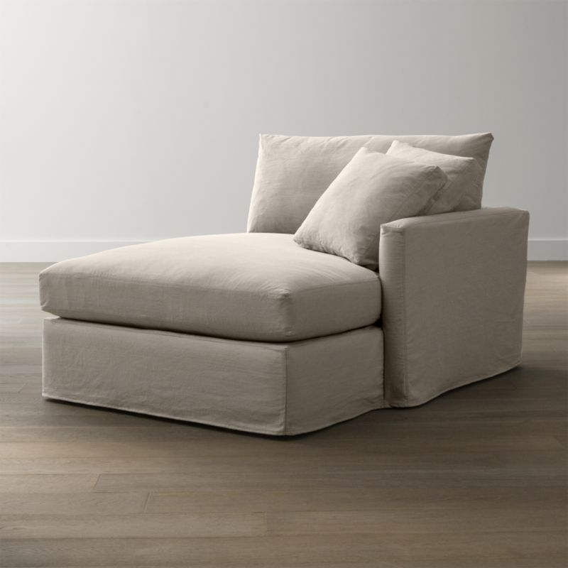 """Tailored to fit our Lounge Slipcovered Left Arm Chaise, smart denim slipcover is tailored with a kickpleat skirt and jumbo double topstitch outlining its high slim arm and plump, deep cushions.<br /><br />Additional <a href=""""http://crateandbarrel.custhelp.com/cgi-bin/crateandbarrel.cfg/php/enduser/crate_answer.php?popup=-1&p_faqid=125&p_sid=DMUxFvPi"""">slipcovers</a> available below and through stores featuring our Furniture Collection.<br /><br />After you place your order, we will send a fabric swatch via next day air for your final approval. We will contact you to verify both your receipt and approval of the fabric swatch before finalizing your order.<br /><br /><NEWTAG/><ul><li>100% cotton</li><li>Machine washable</li><li>Jumbo contrast saddle stitch detail</li><li>Made in North Carolina, USA</li></ul><br />"""