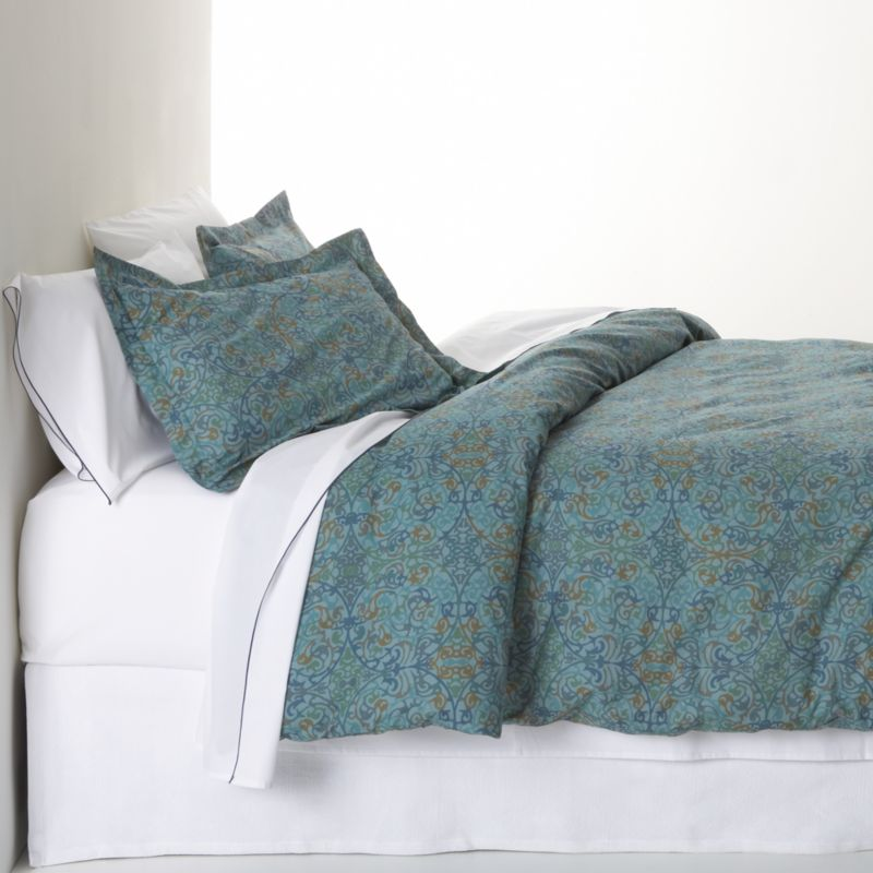 A traditional arabesque pattern scrolls contemporary in a gorgeous palette of blues with flourishes of gold and green. Printed on cotton by an Italian textile house renowned for its richly colored designs that maintain their brilliance over time. Reversible cover has tailored button closure. Duvet inserts also available.<br /><br /><NEWTAG/><ul><li>100% cotton percale</li><li>210-thread-count</li><li>Machine wash</li><li>Made in Italy</li></ul>