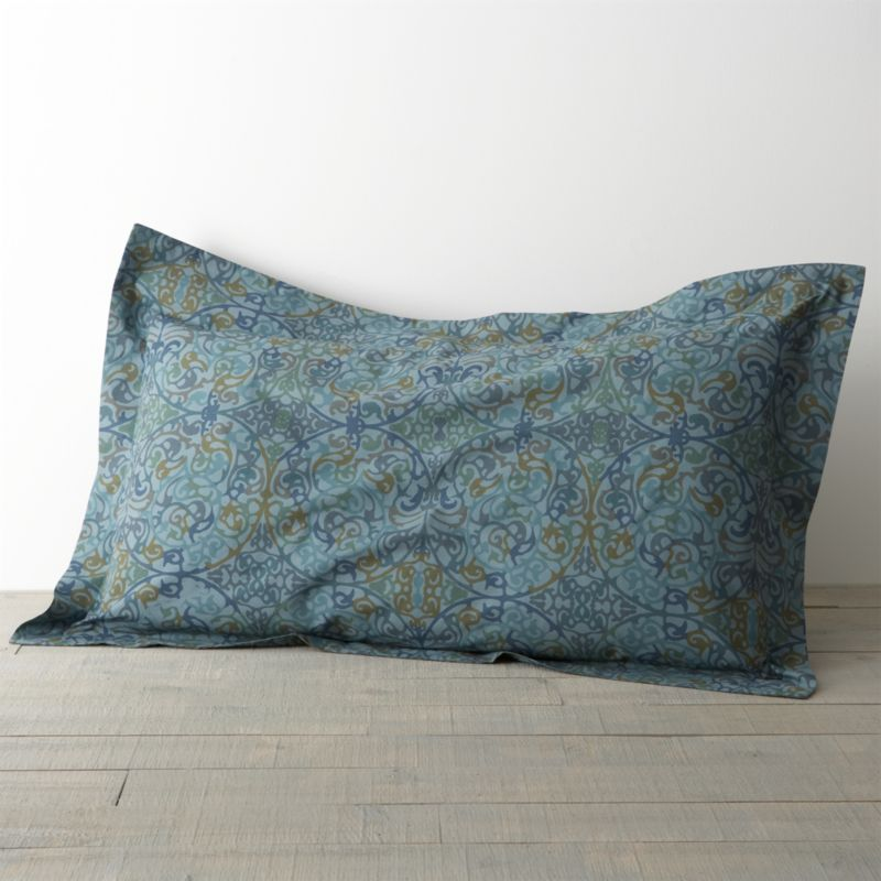 """A traditional arabesque pattern scrolls contemporary in a gorgeous palette of blues with flourishes of gold and green. Printed on cotton by an Italian textile house renowned for its richly colored designs that maintain their brilliance over time. Pillow sham has a generous 2"""" flange and back flap closure. Bed pillows also available.<br /><br /><NEWTAG/><ul><li>100% cotton percale</li><li>210-thread-count</li><li>Machine wash</li><li>Made in Italy</li></ul>"""