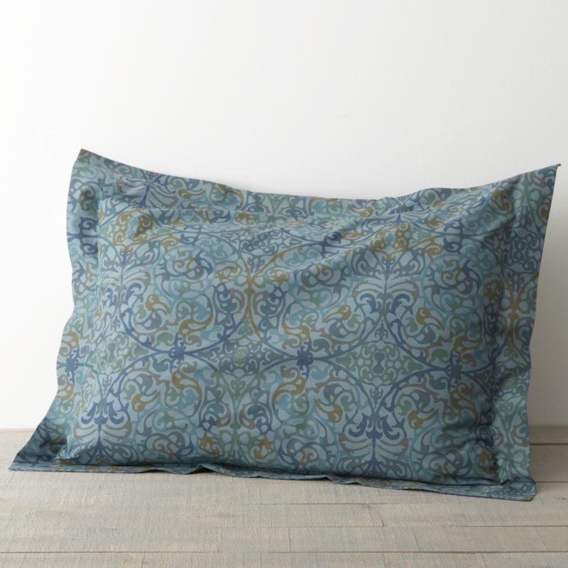 "A traditional arabesque pattern scrolls contemporary in a gorgeous palette of blues with flourishes of gold and green. Printed on cotton by an Italian textile house renowned for its richly colored designs that maintain their brilliance over time. Pillow sham has a generous 2"" flange and back flap closure. Bed pillows also available.<br /><br /><NEWTAG/><ul><li>100% cotton percale</li><li>210-thread-count</li><li>Machine wash</li><li>Made in Italy</li></ul>"