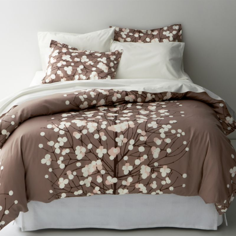 "Designed by Erja Hirvi in 2004, Lumimarja (""snowberries"") is a modern return to organic and natural design encapsulated elegantly in this Marimekko pattern. The snowberry, whose interior resembles crystalline snowflakes, is representative of the beauty that can be found throughout Finland's vast wilderness. Duvet cover reverses to self, with hidden button closure at bottom and interior fabric ties to hold the insert in place. Duvet inserts also available.<br /><br /><NEWTAG/><ul><li>Pattern designed by Erja Hirvi; 2004</li><li>100% cotton sateen</li><li>300-thread-count</li><li>Machine wash cold</li><li>Made in Pakistan</li></ul>"