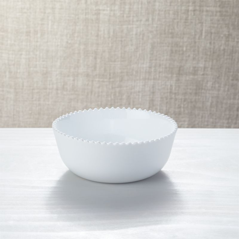 The delicate and graceful Mallorca dinnerware collection is dedicated to fluid forms—wavy, sinuous and curled—in an absence of color, using only white to explore light and shadow. Designed by Paola Navone to be mixed, juxtaposed and overlaid for inspired table settings, white porcelain bowls rim generous coupe shapes with zigzags like the edge of a seashell.<br /><br /><NEWTAG/><ul><li>Porcelain</li><li>34 oz.</li><li>Designed by Paola Navone exclusively for Crate and Barrel</li><li>Dishwasher-, microwave- and oven-safe</li><li>Made in China</li></ul>