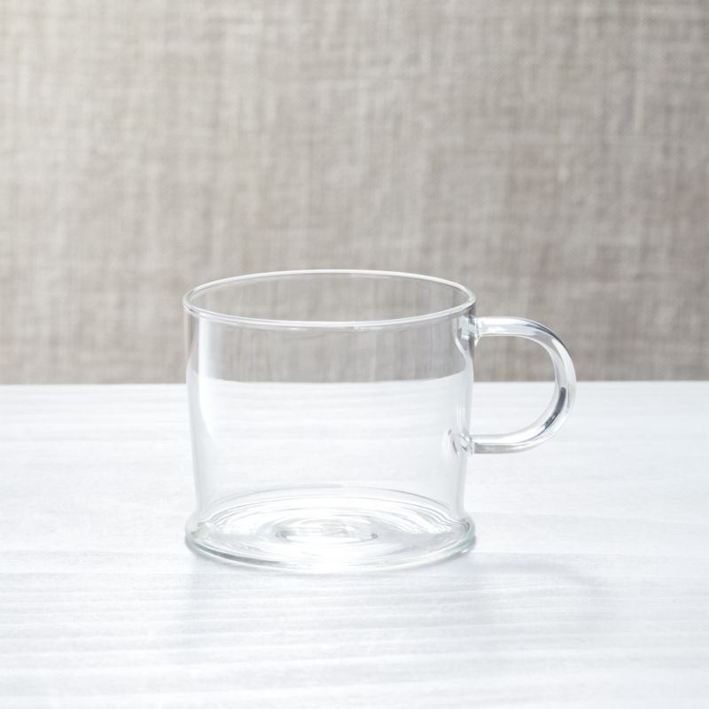 The delicate and graceful Mallorca collection is dedicated to fluid forms—wavy, sinuous and curled—designed by Paola Navone to be mixed, juxtaposed and overlaid for inspired table settings. Clear tube handle adds a fun, contemporary accent to clean-lined, clear glass cup.<br /><br /><NEWTAG/><ul><li>Borosilicate glass cup and Porcelain saucer</li><li>12 oz.</li><li>Designed by Paola Navone exclusively for Crate and Barrel</li><li>Handcrafted</li><li>Dishwasher- and microwave-safe</li><li>Hand washing recommended</li><li>Made in China</li></ul>