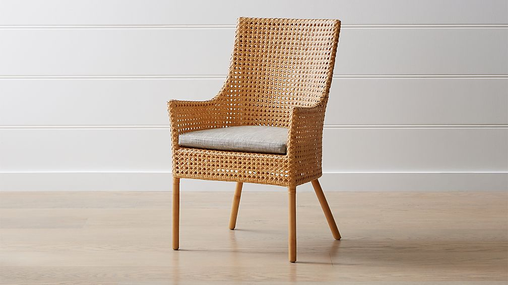 Maluku Natural Rattan Dining Arm Chair And Cushion Crate And Barrel