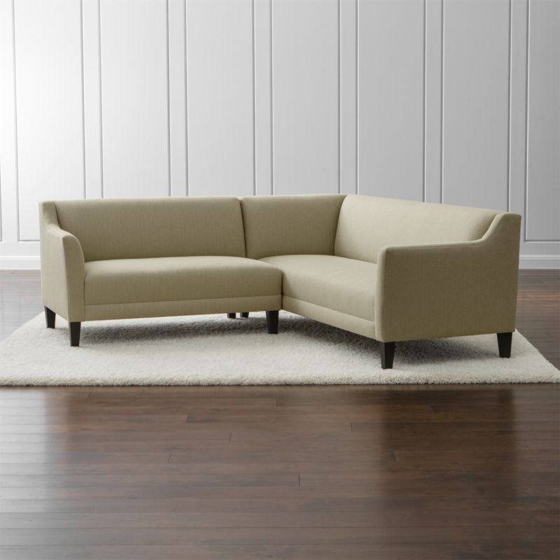Graceful, curvy, petite. Margot makes an impressive statement at an equally impressive value. Scaled for smaller living rooms and apartments, this sectional collection's upright profile features high track arms with a distinct cutaway and modern tapered legs. <NEWTAG/><ul><li>Frame is benchmade with a certified sustainable hardwood that's kiln-dried to prevent warping</li><li>Sinuous wire spring suspension system</li><li>Soy-based polyfoam with fiber seat and back cushions</li><li>Hardwood legs stained with dark jet finish</li><li>Made in North Carolina, USA</li></ul><br />