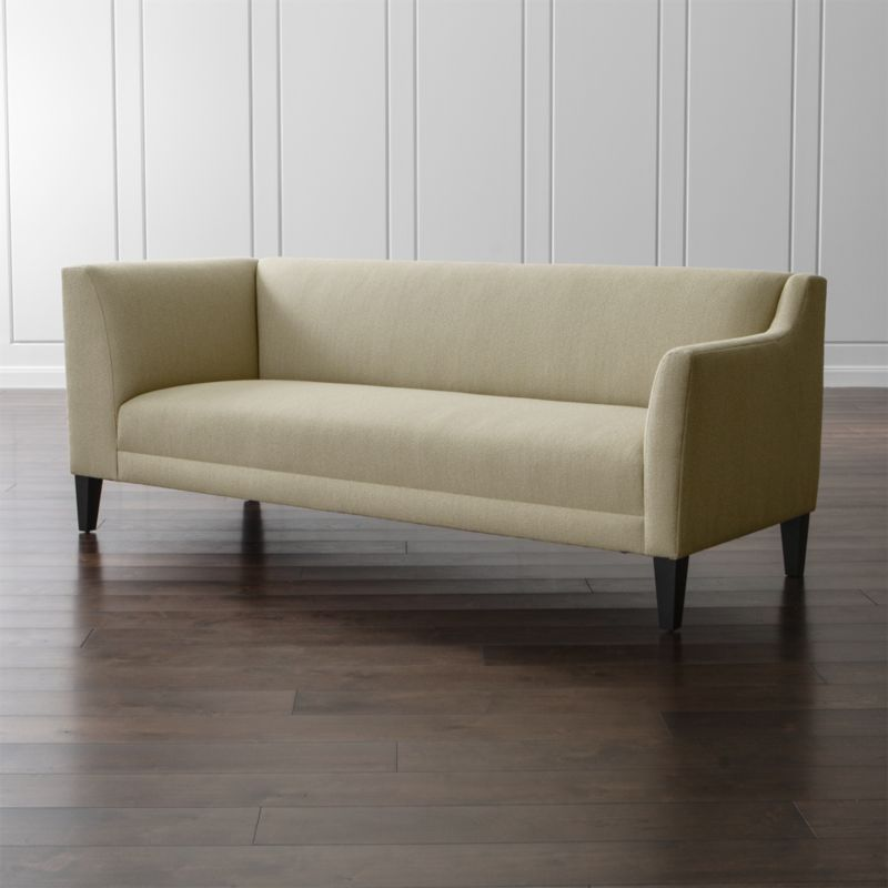 Graceful, curvy, petite. Margot makes an impressive statement at an equally impressive value. Scaled for smaller living rooms and apartments, this right arm sectional corner sofa's upright profile features one high track arm with a distinct cutaway and modern tapered legs. <NEWTAG/><ul><li>Frame is benchmade with a certified sustainable hardwood that's kiln-dried to prevent warping</li><li>Sinuous wire spring suspension system</li><li>Soy-based polyfoam with fiber seat and back cushions</li><li>Hardwood legs stained with dark jet finish</li><li>Made in North Carolina, USA of domestic and imported materials</li></ul><br />