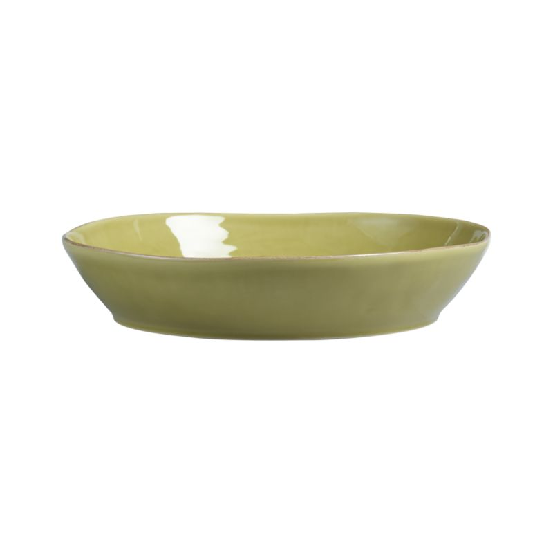 Artisanal ceramic shapes are glazed a soft green with subtle hand-antiquing on the freeform rims. Also available in white.<br /><br /><strong>Please note:</strong> The Marin Green Centerpiece Bowl will be discontinued in January 2013. When our current inventory is sold out, it is unlikely we will be able to obtain more.<br /><br /><NEWTAG/><ul><li>Stoneware</li><li>Dishwasher-, microwave- and oven-safe to 300 degrees</li></ul>