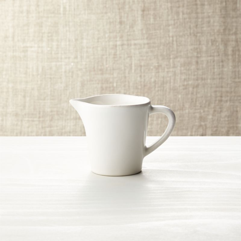 Artisanal ceramic sugar and creamer are glazed a soft white with subtle hand-antiquing on the freeform rims.<br /><br /><NEWTAG/><ul><li>Stoneware</li><li>10 oz.</li><li>Dishwasher-, microwave- and oven-safe to 300 degrees</li><li>Made in Portugal</li></ul>