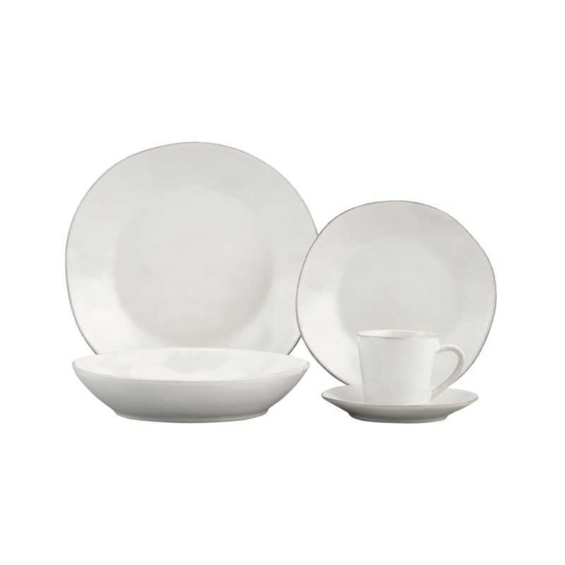 Artisanal ceramic shapes are glazed a soft white with subtle hand-antiquing on the freeform rims.<br /><br /><NEWTAG/><ul><li>Stoneware</li><li>Dishwasher-, microwave- and oven-safe to 300 degrees</li></ul>