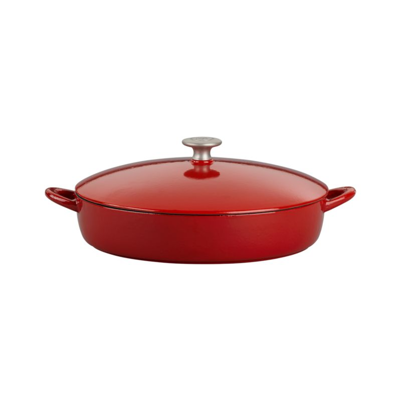"Our ""Italian Cooking Essentials"" collection from famed chef and restaurateur Mario Batali expands with a Bistro Pan in red. Enameled cast iron pan ensures superior low-heat cooking and exceptional heat retention. Oven or stovetop, this versatile pan is ideal for braising, one-pot meals, stocks, sauces and more. Close-fitting lid traps moisture; large handle makes for easy oven-to-table transport. Clean in the dishwasher, with Bar Keepers Friend or baking soda as described below.<br /><br /><NEWTAG/><ul><li>Cast iron with enamel coating</li><li>Cast stainless steel knob</li><li>Especially suited for low-heat cooking</li><li>For stovetop and oven use to 475 degrees</li><li>For use with traditional gas and electric, or ceramic (up to medium heat only) and induction cooktops</li><li>Dishwasher-safe; clean with Bar Keepers Friend; or for stains and more thorough cleaning: pour ½ cup of baking soda into a small bowl. Gradually add small amounts of water to the baking soda, mixing until a paste is formed. Apply the paste to the enamel cast iron cookware and allow to soak for one hour. Use a cellulose sponge to gently scrub the stain from the cookware.</li><li>Made in China</li></ul><br />"