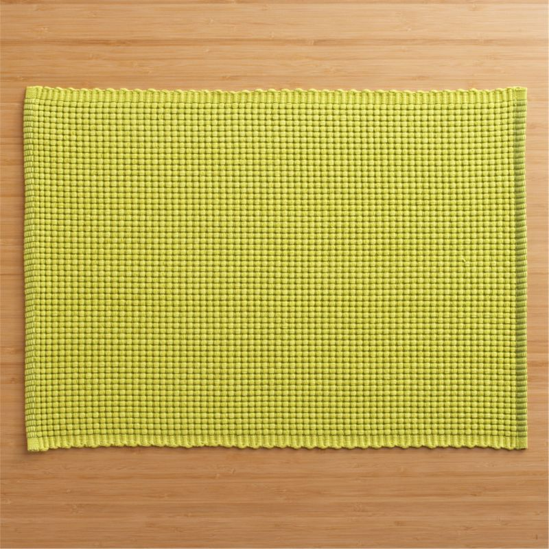Hand-dyed, hand-woven cotton placemat textures chunky and graphic in pure, vivid color.<br /><br /><NEWTAG/><ul><li>100% cotton</li><li>Oversized to allow for shrinkage</li><li>Machine wash, reshape and dry flat</li></ul>