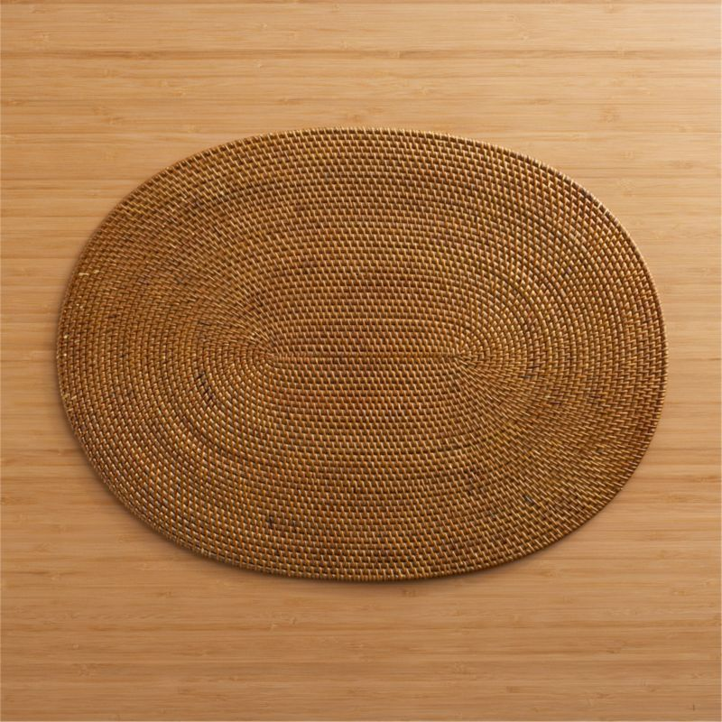 Island dining chic in a woven fiber oval with warm honey finish.<br /><br /><NEWTAG/><ul><li>Placemat is 60% ate, 40% rattan</li><li>Clean placemat with a damp cloth</li></ul>