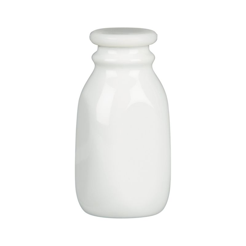 "Nostalgic porcelain bottle in a classic milk-bottle shape gives new life to the term ""milk glass."" Store-and-serve bottle is fitted with a silicone lid.<br /><br /><NEWTAG/><ul><li>Porcelain</li><li>BPA free silicone lids</li><li>Bottle is dishwasher-safe</li></ul>"