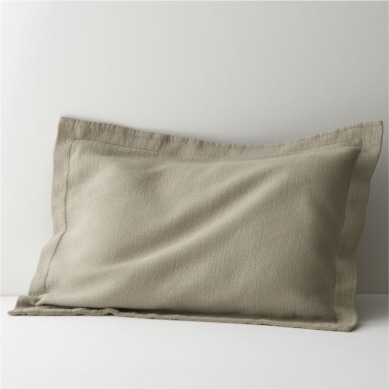 """Delicious mocha bedding layers the bed in warm color, the perfect accompaniment to a range of solids and prints. Ultra-soft fabric is jacquard-loomed cotton stitched as a modern, textured matelassé. Chic 2"""" flange. Bed pillows also available.<br /><br /><NEWTAG/><ul><li>100% cotton</li><li>256-thread-count</li><li>Machine wash cold, tumble dry low</li><li>Made in Portugal</li></ul>"""