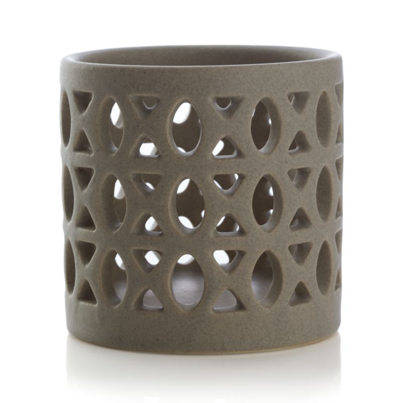 Evocative Moroccan-inspired stoneware wraps a candle in an intricate web, flickering warm, romantic lighting with a hint of exotic. Pairs with matching Molly hurricane.<br /><br /><NEWTAG/><ul><li>Stoneware</li><li>Accommodates a standard tealight or votive candle, sold separately</li><li>Dust with soft dry cloth</li><li>Made in China</li></ul>