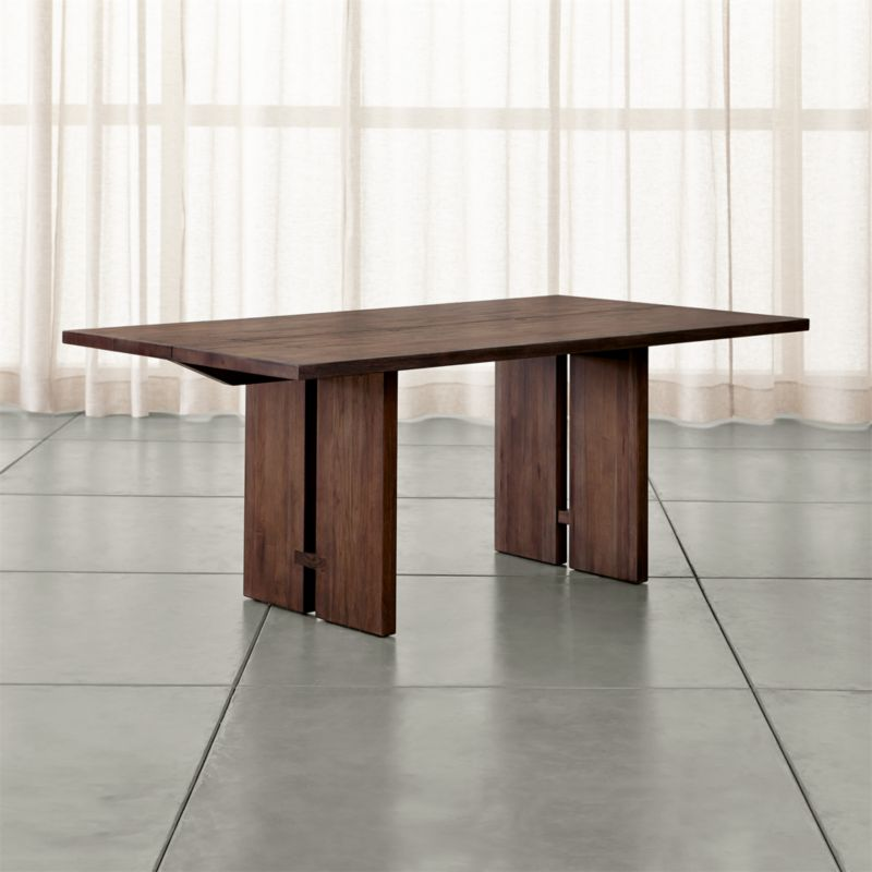 Our Monarch dining collection is handcrafted using centuries-old techniques in a modern way. Rare lengths of solid walnut chosen for their beautiful cathedral graining, are united on top with traditional wood-on-wood butterfly joinery without using nails or screws. <NEWTAG/><ul><li>Solid walnut</li><li>Shiitake finish</li><li>Water-based polyurethane topcoat is resistant to stains from water, wine, coffee and tea; heat-resistant up to 70°C</li><li>Protective use of coasters, placemats and trivets recommended</li><li>Avoid the use of ammonia-based cleaning solutions</li><li>Traditional wood-on-wood joinery</li><li>Seats six</li><li>Made in China</li></ul>