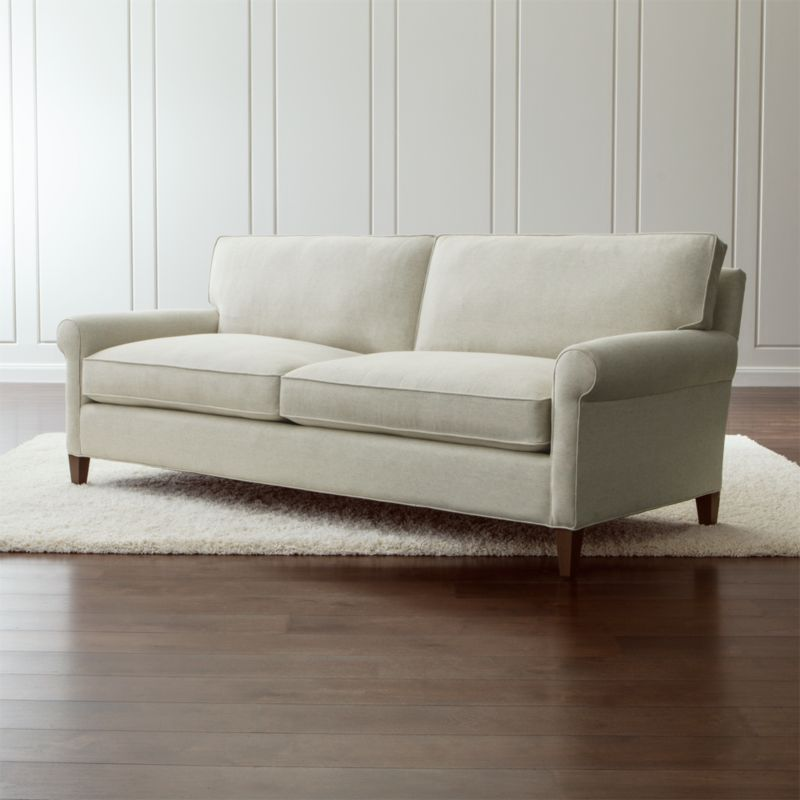 Well-balanced and beautifully tailored, Montclair is a model of classic proportions. Trim roll arms set the tone for this refined, 2-seat living room sofa that sits a bit more upright—not too low, not too deep—but with plenty of comfort. <NEWTAG/><ul><li>Frame is benchmade with a certified sustainable hardwood that's kiln-dried to prevent warping</li><li>Flexolator spring suspension system</li><li>Soy-based polyfoam seat cushions wrapped in fiber-down blend and encased in downproof ticking</li><li>Fiber-down blend back cushions encased in downproof ticking</li><li>Hardwood legs stained with a light brown finish</li><li>Made in North Carolina, USA</li></ul>