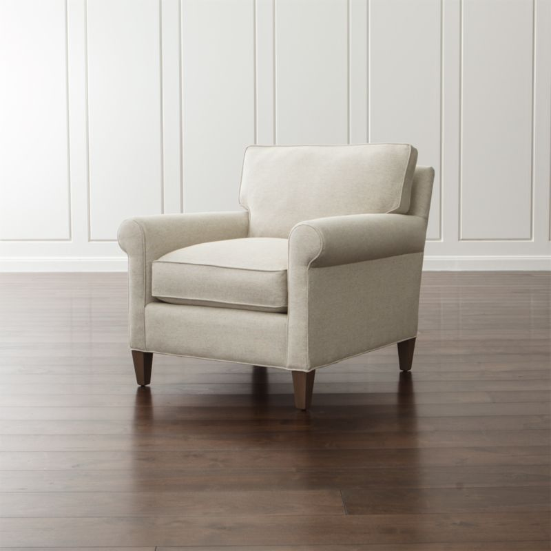 Well-balanced and beautifully tailored, Montclair is a model of classic proportions. Trim roll arms set the tone for this refined chair that sits a bit more upright—not too low, not too deep—but with plenty of comfort. <NEWTAG/><ul><li>Frame is benchmade with a certified sustainable hardwood that's kiln-dried to prevent warping</li><li>Flexolator spring suspension system</li><li>Soy-based polyfoam seat cushion wrapped in fiber-down blend and encased in downproof ticking</li><li>Fiber-down blend back cushion encased in downproof ticking</li><li>Hardwood legs stained with a light brown finish</li><li>Made in North Carolina, USA</li></ul>