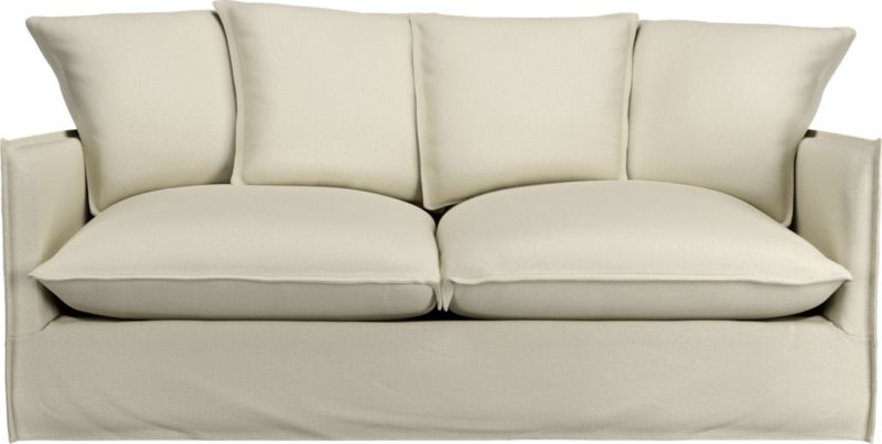 "Slipcover for Oasis Apartment Sofa is 100% linen tailored fresh with a fashionable flanged edge and casual drape at the floor.<br /><br />Additional <a href=""http://crateandbarrel.custhelp.com/cgi-bin/crateandbarrel.cfg/php/enduser/crate_answer.php?popup=-1&p_faqid=125&p_sid=DMUxFvPi"">slipcovers</a> available below and through stores featuring our Furniture Collection.<br /><br />After you place your order, we will send a fabric swatch via next day air for your final approval. We will contact you to verify both your receipt and approval of the fabric swatch before finalizing your order.<br /><br /><NEWTAG/><ul><li>100% linen</li><li>Dry cleaning recommended</li><li>Made in North Carolina, USA</li></ul>"