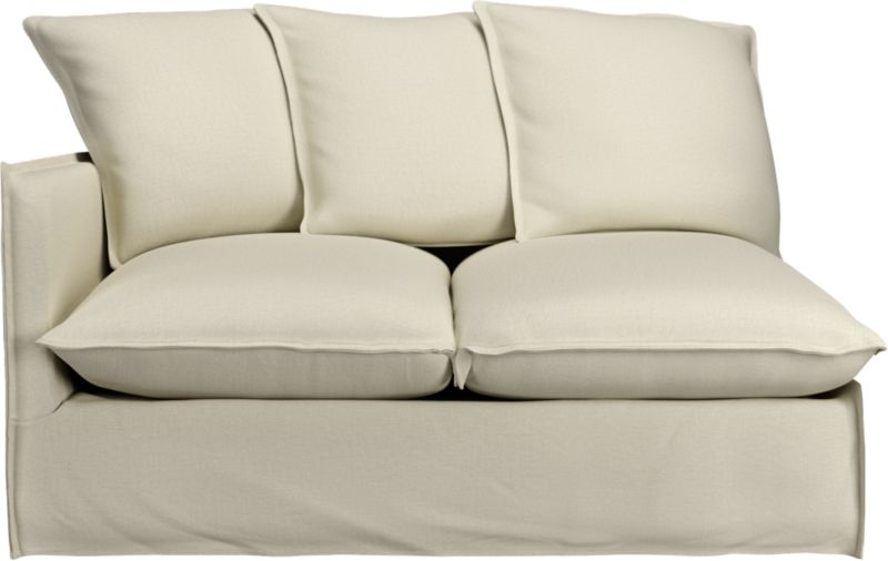 "Slipcover for Oasis Left Arm Loveseat is 100% linen tailored fresh with a fashionable flanged edge and casual drape at the floor.<br /><br />Additional <a href=""http://crateandbarrel.custhelp.com/cgi-bin/crateandbarrel.cfg/php/enduser/crate_answer.php?popup=-1&p_faqid=125&p_sid=DMUxFvPi"">slipcovers</a> available below and through stores featuring our Furniture Collection.<br /><br />After you place your order, we will send a fabric swatch via next day air for your final approval. We will contact you to verify both your receipt and approval of the fabric swatch before finalizing your order.<br /><br /><NEWTAG/><ul><li>100% linen</li><li>Dry cleaning recommended</li></ul><br />"