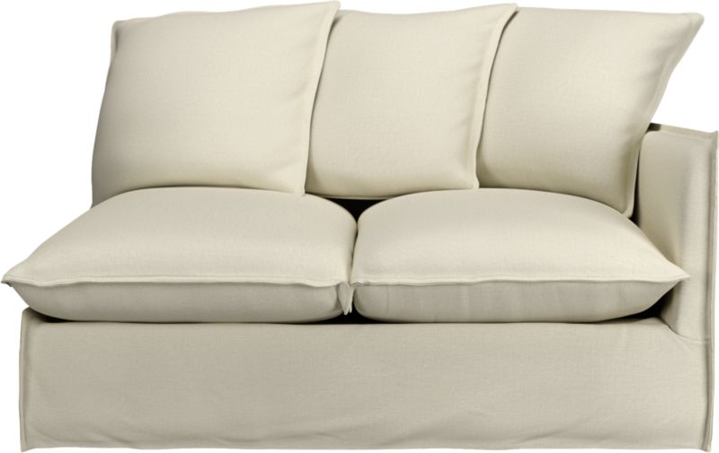 "Slipcover for Oasis Right Arm Loveseat is 100% linen tailored fresh with a fashionable flanged edge and casual drape at the floor.<br /><br />Additional <a href=""http://crateandbarrel.custhelp.com/cgi-bin/crateandbarrel.cfg/php/enduser/crate_answer.php?popup=-1&p_faqid=125&p_sid=DMUxFvPi"">slipcovers</a> available below and through stores featuring our Furniture Collection.<br /><br />After you place your order, we will send a fabric swatch via next day air for your final approval. We will contact you to verify both your receipt and approval of the fabric swatch before finalizing your order.<br /><br /><NEWTAG/><ul><li>100% linen</li><li>Dry cleaning recommended</li></ul><br />"