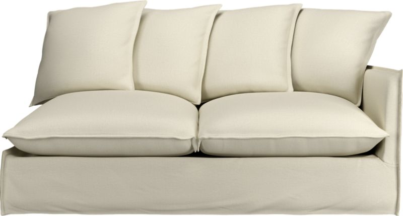 """Slipcover for Oasis Right Arm Sofa is 100% linen tailored fresh with a fashionable flanged edge and casual drape at the floor.<br /><br />Additional <a href=""""http://crateandbarrel.custhelp.com/cgi-bin/crateandbarrel.cfg/php/enduser/crate_answer.php?popup=-1&p_faqid=125&p_sid=DMUxFvPi"""">slipcovers</a> available below and through stores featuring our Furniture Collection.<br /><br />After you place your order, we will send a fabric swatch via next day air for your final approval. We will contact you to verify both your receipt and approval of the fabric swatch before finalizing your order.<br /><br /><NEWTAG/><ul><li>100% linen</li><li>Dry cleaning recommended</li></ul><br />"""