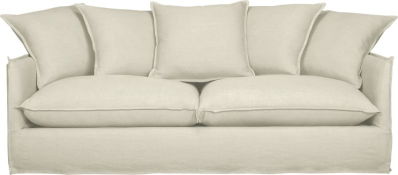 """Slipcover for Oasis Sofa is 100% linen tailored fresh with a fashionable flanged edge and casual drape at the floor.<br /><br />Additional <a href=""""http://crateandbarrel.custhelp.com/cgi-bin/crateandbarrel.cfg/php/enduser/crate_answer.php?popup=-1&p_faqid=125&p_sid=DMUxFvPi"""">slipcovers</a> available below and through stores featuring our Furniture Collection.<br /><br />After you place your order, we will send a fabric swatch via next day air for your final approval. We will contact you to verify both your receipt and approval of the fabric swatch before finalizing your order.<br /><br /><NEWTAG/><ul><li>100% linen</li><li>Dry cleaning recommended</li><li>Made in North Carolina, USA</li></ul>"""
