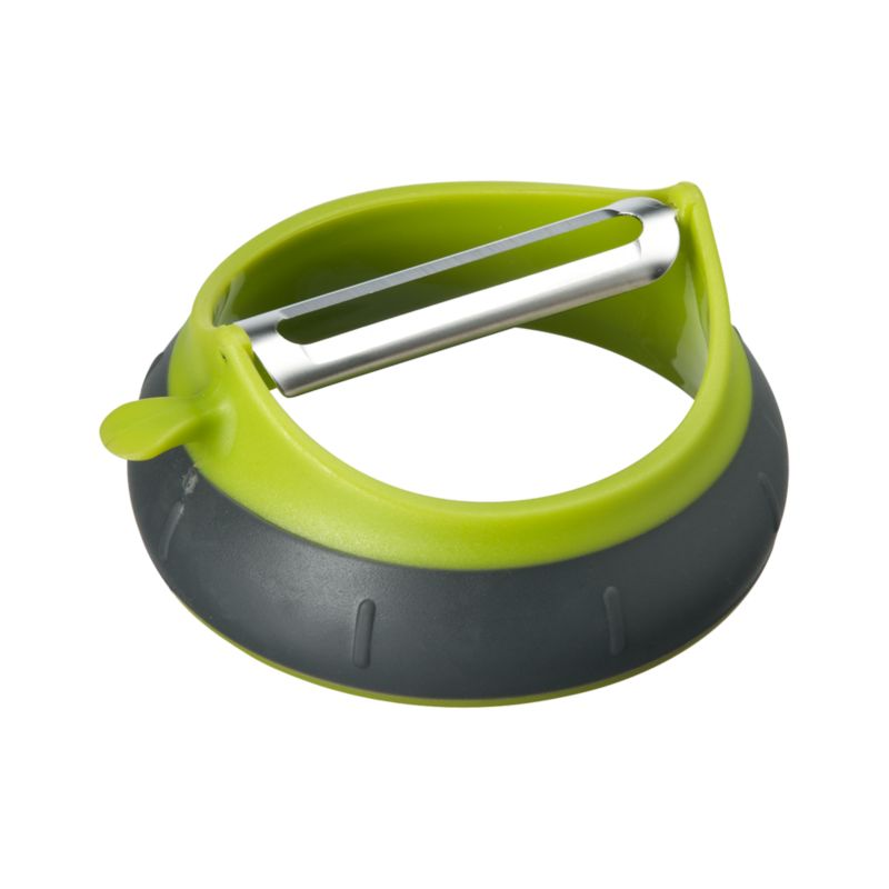 A new idea in peelers puts the action right in the palm of your hand. Non-slip round peeler with multi-directional head is easy to use with either hand. Open design allows you to see the food as you peel. Each has a built-in eyer/blemish remover.<br /><br /><NEWTAG/><ul><li>Hardened stainless steel blade</li><li>Polypropylene handle with thermoplastic rubber grip</li><li>Dishwasher-safe</li></ul>