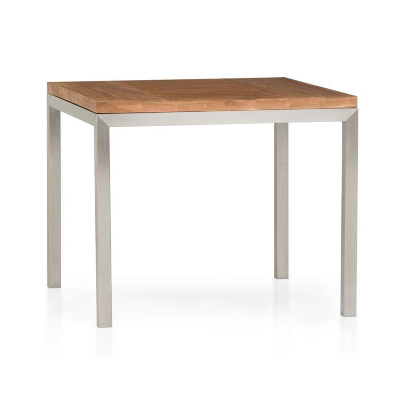 Start with a great base. Top it off with an amazing top. Voila—the perfect table. Stainless-steel frame with a contemporary matte finish supports with clean simple lines. Gorgeous wood top is handcrafted from repurposed teak from Southeast Asia with variations in wood grains, texture and color, knots and other naturally occurring characteristics that add to the distinct character. Seats four.<br /><br /><NEWTAG/><ul><li>100% reclaimed, unfinished teak</li><li>Naturally occurring texture and knots</li><li>Stainless-steel base with matte finish</li><li>Clear powdercoat finish on base</li><li>Seats four</li><li>Clean with mild soap and water</li><li>Made in Indonesia and China</li></ul>