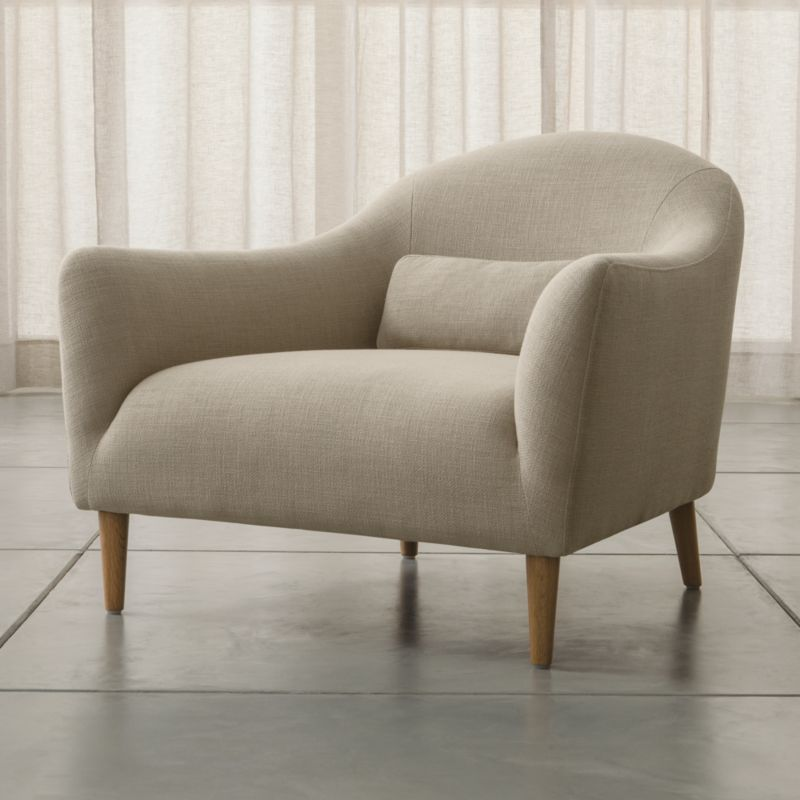 Sleek curves flare out to invite you in to this affordable furniture collection for small rooms and apartments by London-based designer Bethan Gray. Every turn of the chair's graceful tight back and plush seat is hugged by a textured, linen-blend weave. A coordinating kidney pillow supports your lower back; tapered legs are made of solid white oak. <NEWTAG/><ul><li>Designed by Bethan Gray</li><li>Frame is made with a certified sustainable solid wood and engineered hardwood</li><li>Sinuous wire spring and synthetic web suspension systems</li><li>High-resiliency, high-density foam and polyfiber back and seat cushions</li><li>Fiber-down blend kidney pillow encased in downproof ticking</li><li>Solid white oak legs with clear lacquer finish</li><li>Made in China</li></ul>
