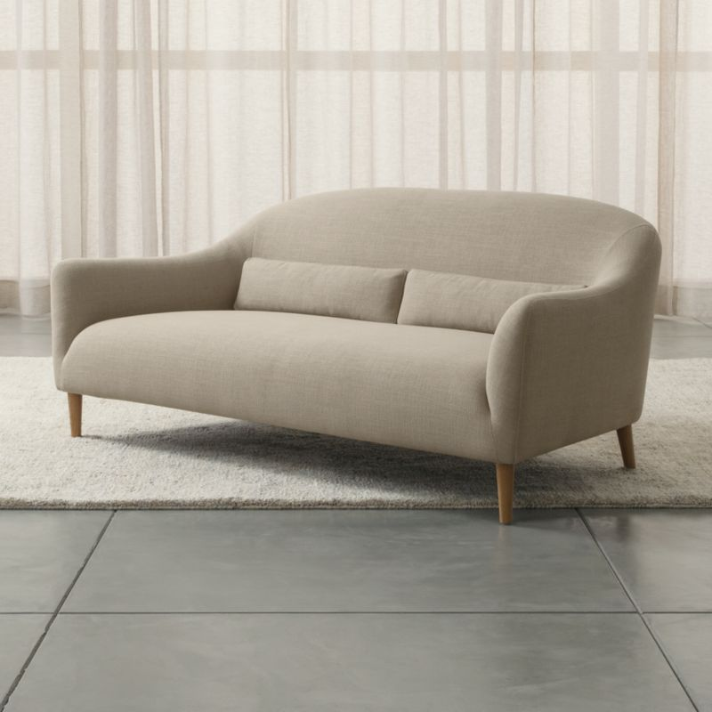 Sleek curves flare out to invite you in to this affordable furniture collection for small rooms and apartments by London-based designer Bethan Gray. Every turn of the sofa's graceful tight back and plush seat is hugged by a textured, linen-blend weave. Two coordinating kidney pillows support your lower back; tapered legs are made of solid white oak. <NEWTAG/><ul><li>Designed by Bethan Gray</li><li>Frame is made with a certified sustainable solid wood and engineered hardwood</li><li>Sinuous wire spring and synthetic web suspension systems</li><li>High-resiliency, high-density foam and polyfiber back and seat cushions</li><li>Fiber-down blend kidney pillows encased in downproof ticking</li><li>Solid white oak legs with clear lacquer finish</li><li>Made in China</li></ul>